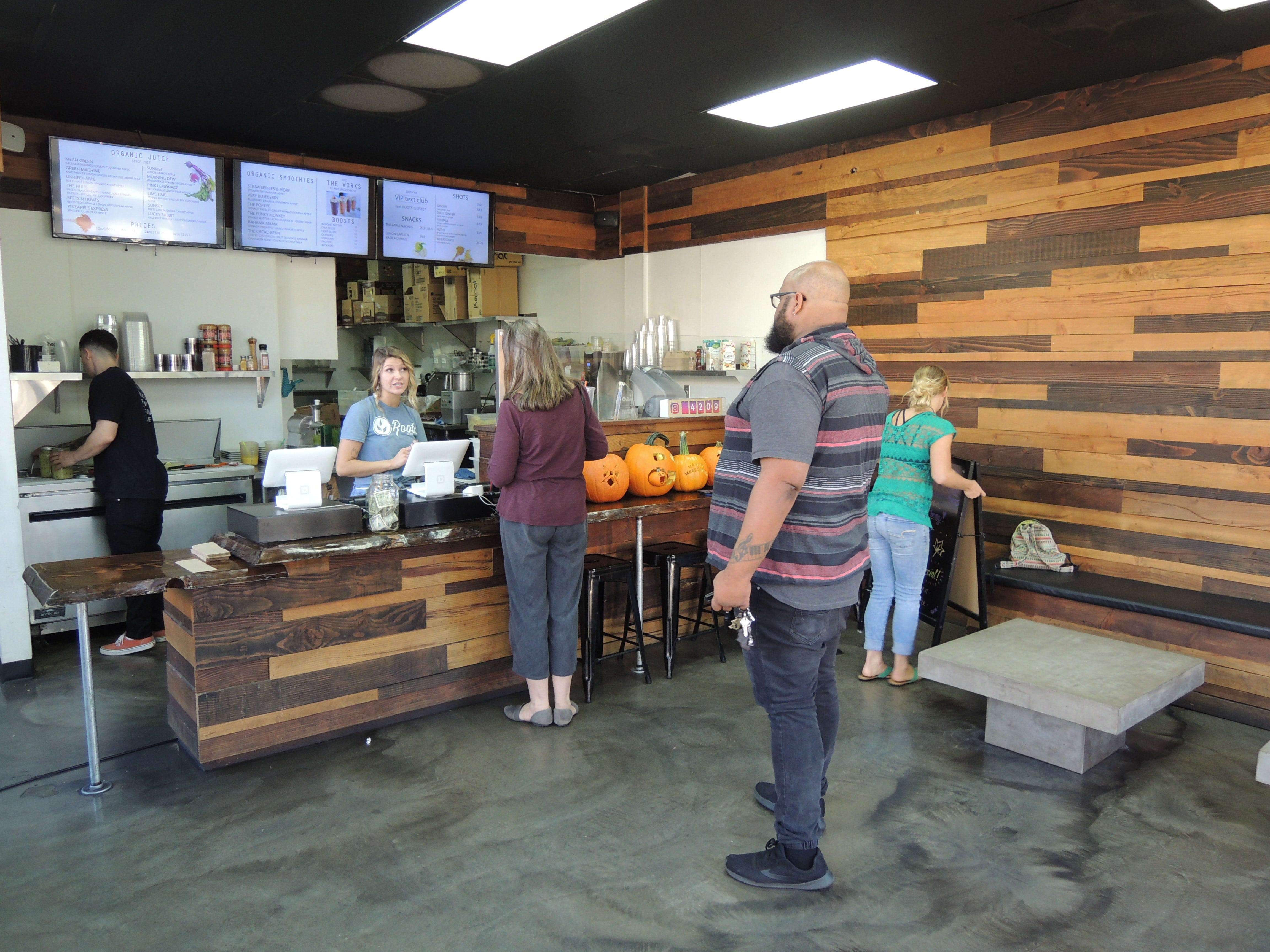 Customers place orders at Roots Juice Bar.