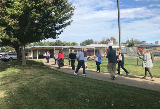 Redding School District employees return to work Thursday after authorities checked the offices and rooms off East Bonnyview Road for signs of a bomb. The office received a phoned-in bomb threat about noon Thursday but no explosive devices were found.
