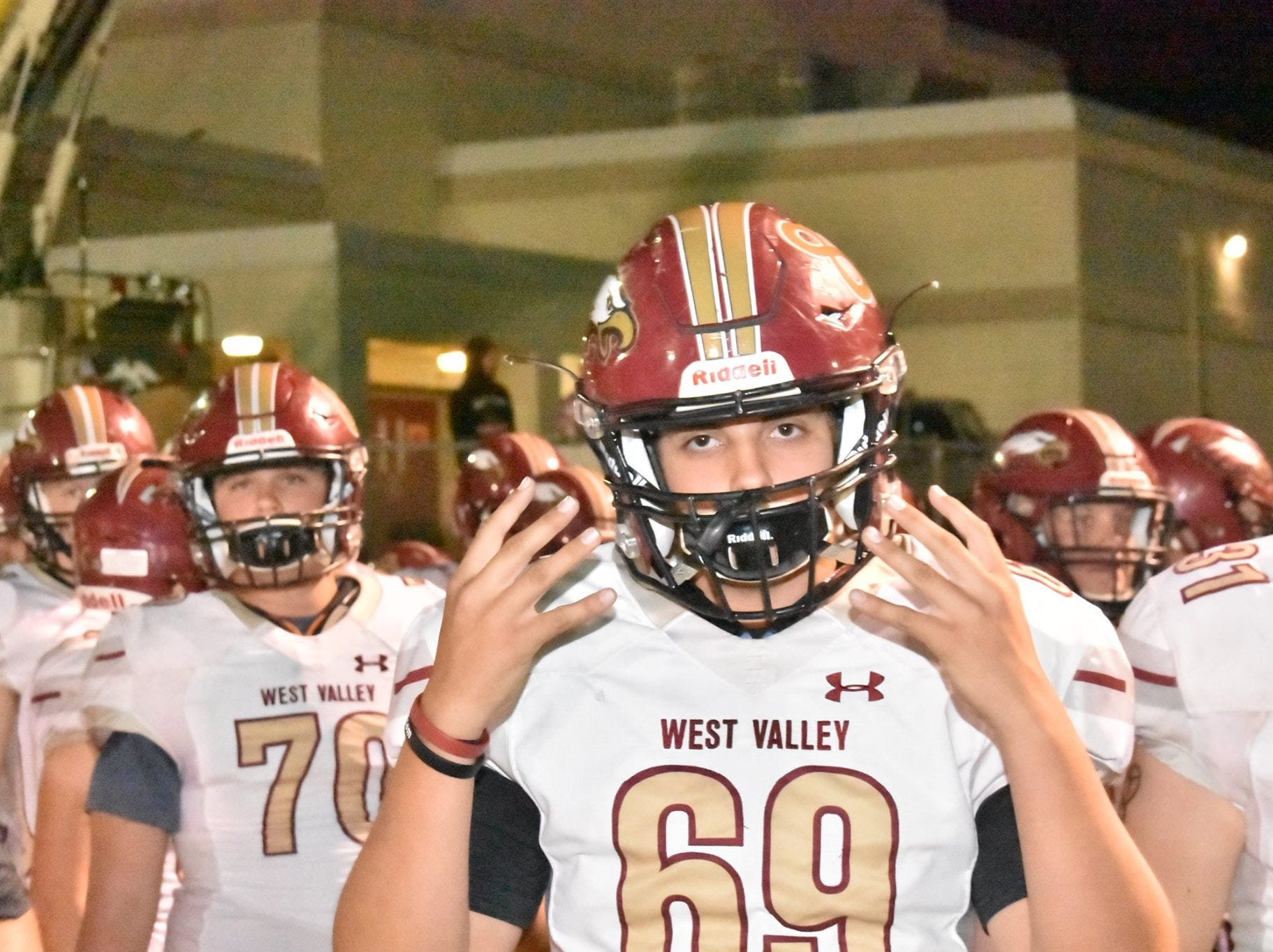 West Valley's Ethan Croup holds up eight fingers to honor Tyson Wacker on Friday, Oct. 19, before a game against Corning. Wacker, a junior defensive end, was injured in a vehicle crash on Oct. 18  died as a result of his injuries the following Monday.