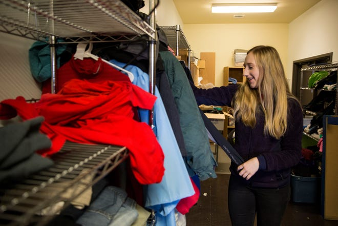 South Salem senior, Claire Adams sorts through jackets the leadership program at her school collected on Tuesday, Oct. 23, 2018. Adams is working to raise money for mobile showers for homeless people.