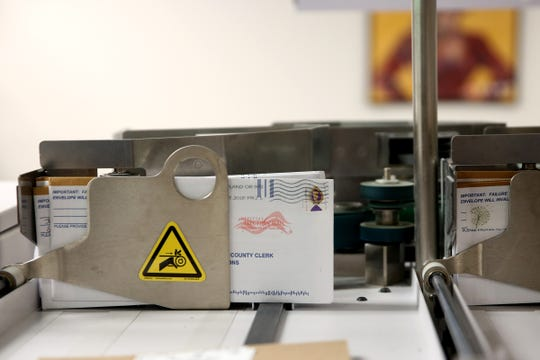 Ballots are sorted at the Marion County Elections Office in Salem on Thursday, Oct. 25, 2018.