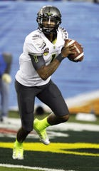 Oregon quarterback Darron Thomas warms up before the national championship game Jan. 10, 2011, against Auburn.