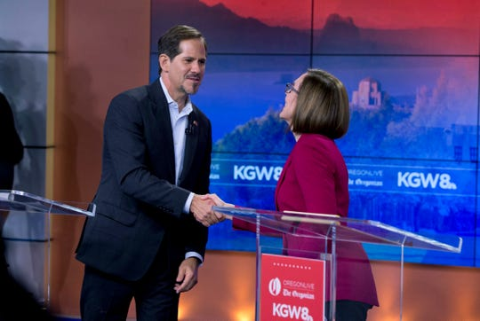 Oregon Governor Kate Brown, right, shakes hands with Rep. Knute Buehler at their final debate at KGW-TV studios in Southwest Portland, Ore. Distinctions emerged between Oregon's leading gubernatorial candidates in their final debate as the two clashed public pensions, immigration, the state's housing crisis and several other hot-button issues.