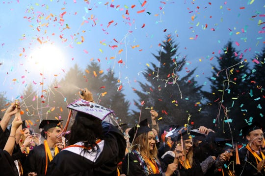 Graduates celebrate with confetti and silly string during the Sprague High School commencement at Sprague High School, June 8, 2018.