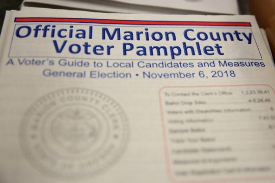 A voter pamphlet at the Marion County Elections Office in Salem on Thursday, Oct. 25, 2018.