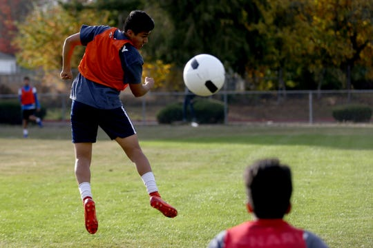 Boys soccer practice at McNary High School in Keizer on Wednesday, Oct. 24, 2018.