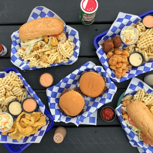 Nw Overhead Shot Catfish Dinner Poboy Shrimp Dinner Poboy 2 Cheeseburgers