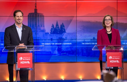 Oregon Governor Kate Brown, right, and Rep. Knute Buehler appear during their final debate at KGW-TV studios in Southwest Portland, Ore. Distinctions emerged between Oregon's leading gubernatorial candidates in their final debate as the two clashed public pensions, immigration, the state's housing crisis and several other hot-button issues.