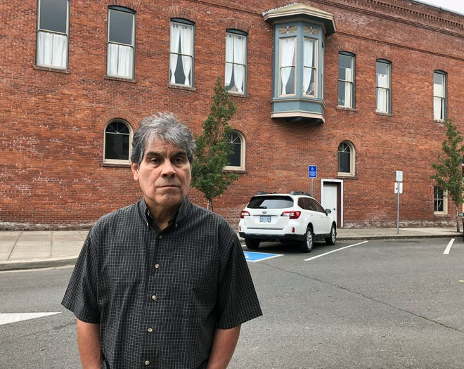 In this Oct. 23, 2018 photo, Delmiro Trevino poses in front of a building in Independence, Ore., where the Hi-Ho restaurant used to be located. It was in that restaurant, in 1977, that Trevino was in when three sheriff's deputies and a policewoman came in and demanded he show documents proving he was American. The racial profiling of Trevino, an American born in Texas, led to Oregon becoming America's first sanctuary state. Now, Oregonians are deciding in the Nov. 6 election whether to repeal the law, even as some other states, like Vermont, have adopted sanctuary policies and others, like Texas, have banned towns from adopting them.