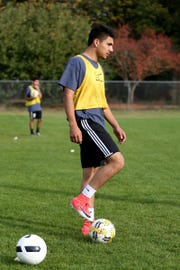 Senior center back Jesus Lopez works during boys soccer practice at McNary High School in Keizer on Wednesday, Oct. 24, 2018.