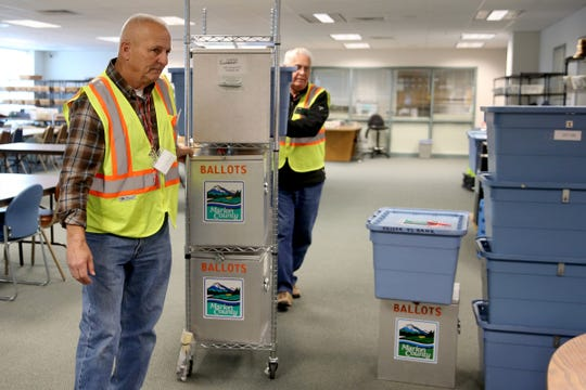 Bruce Moyer, left, and Bob Bruce, Marion County Elections Ballot Couriers, deliver ballot boxes from around the area to the Marion County Elections Office in Salem on Thursday, Oct. 25, 2018.