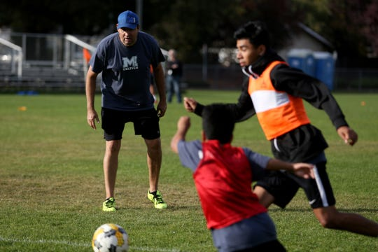 Head coach Miguel Camarena watches his team during boys soccer practice at McNary High School in 2018. The Celtics are 4-2 and ranked No. 19 in the state this season as they prepare for the start of the Mountain Valley Conference season.
