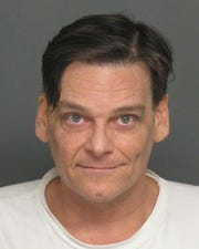 Peter Wells mug shot from his 2011 arrest.