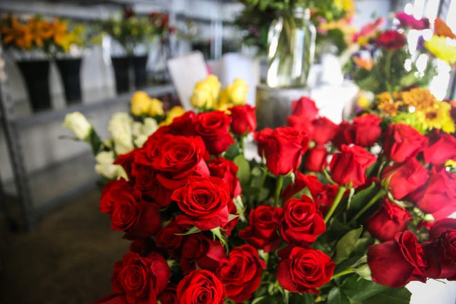 Roses and other flowers are stored in the cooler Tuesday, Oct. 23, 2018, at Friendly Flower Shop.