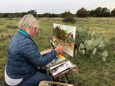 Kathie Odom from Tennessee paints during EnPleinAirTEXAS Monday, Oct. 22, 2018, at the Door Key Ranch.