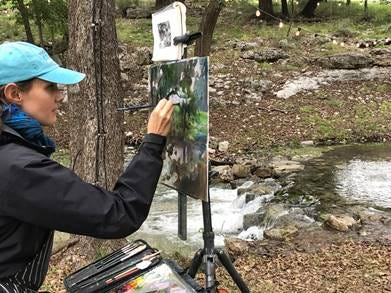 Kathleen Hudson of Kentucky paints during EnPleinAirTEXAS at Millpond Ranch in Christoval.