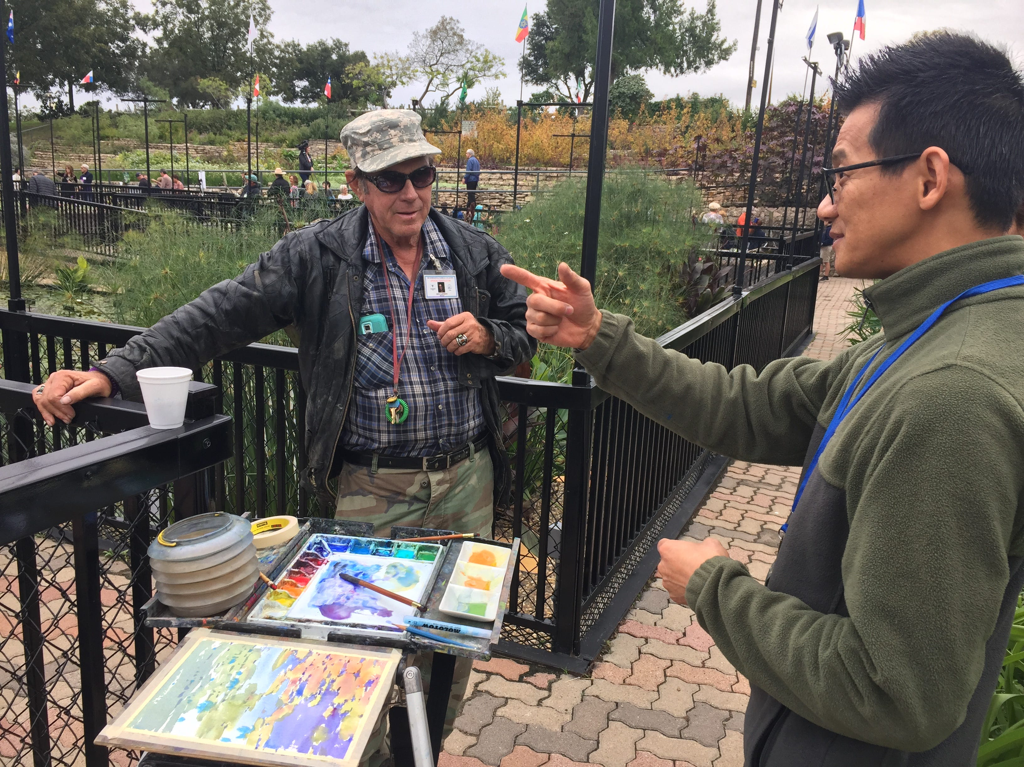 Ken Landon chats with artist Yong Hong Zhong during EnPleinAirTEXAS Tuesday, Oct. 23, 2018, at the International Waterlily Collection in the Civic League Park.