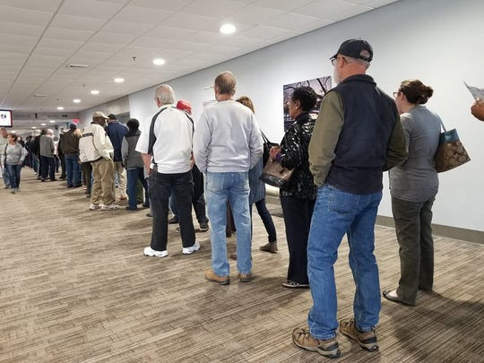 A line forms in the hallway of the Wicomico Youth & Civic Center in Salisbury for the first day of early voting on Thursday, Oct. 25, 2018.