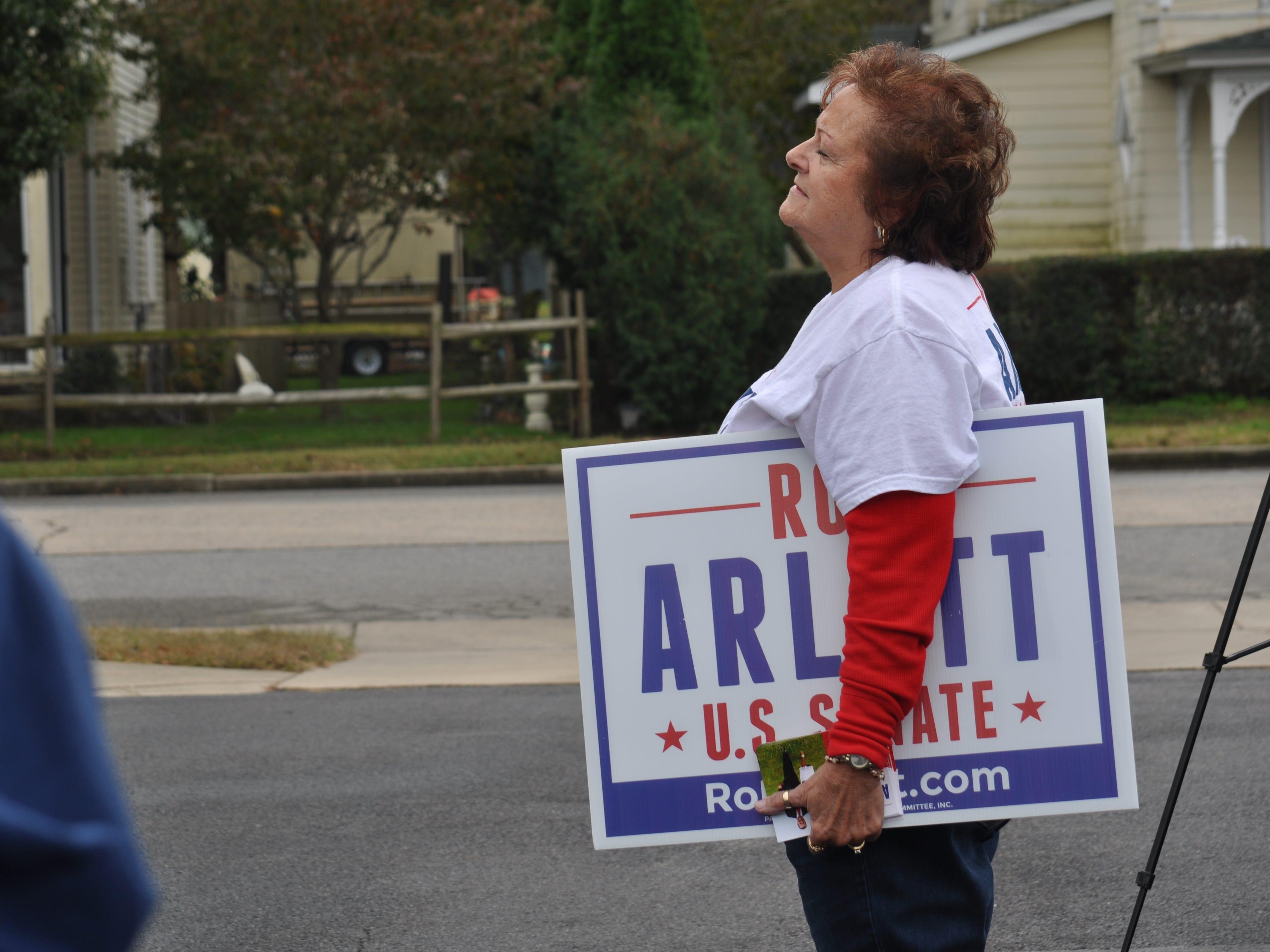 A supporter listens to U.S. Senate candidate Rob Arlett during his Bridgeville stump speech on Oct. 20.