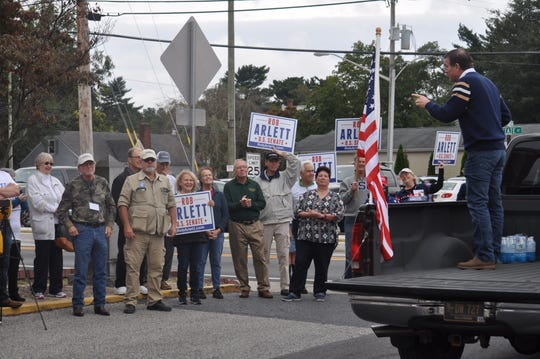 U.S. Senate candidate Rob Arlett speaks to a group of supporters in Millsboro.