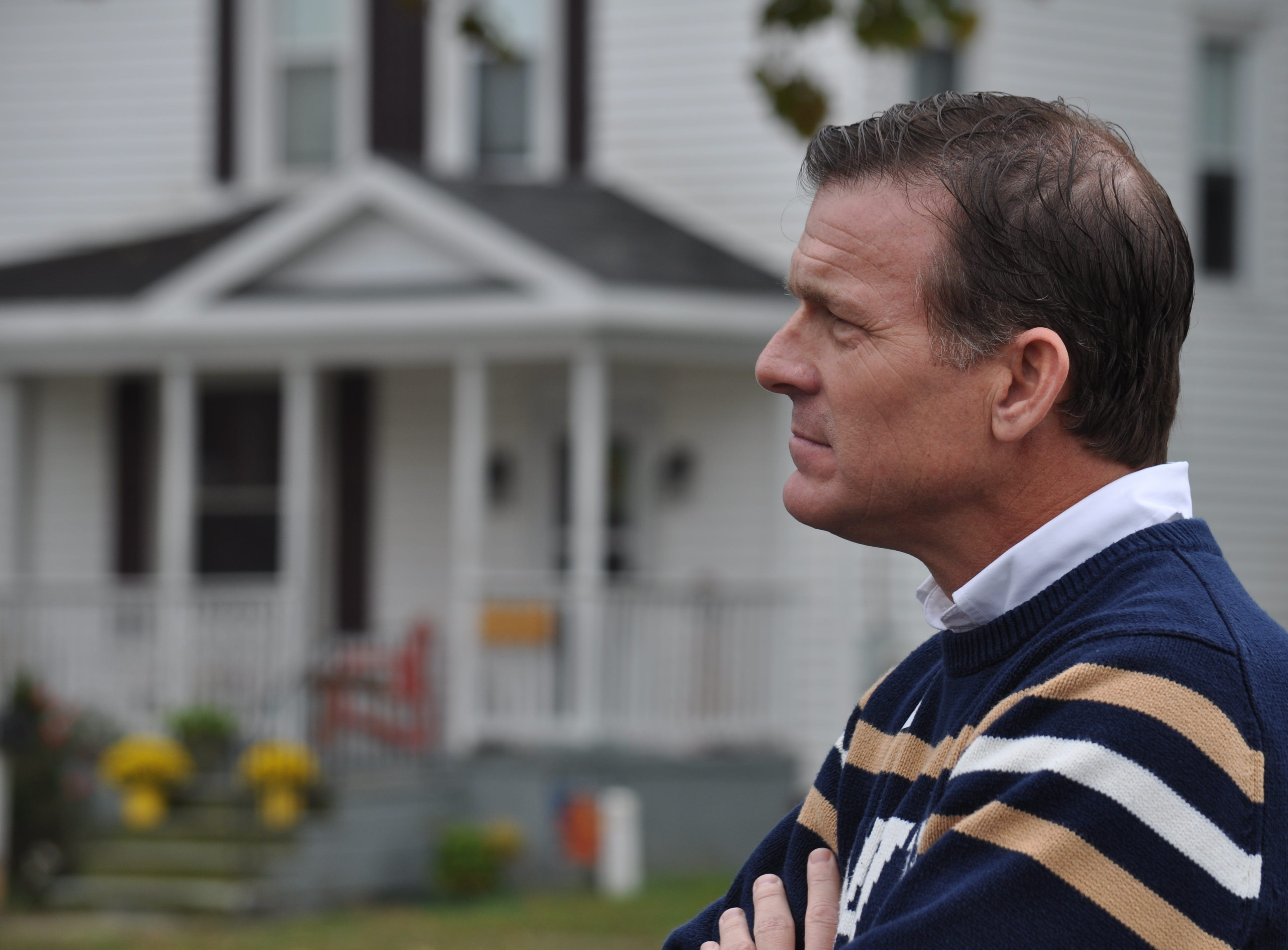 Sussex County Councilman and U.S. Senate candidate Rob Arlett listens to a supporter speak in Bridgeville on his Sussex County tour on Oct. 20.