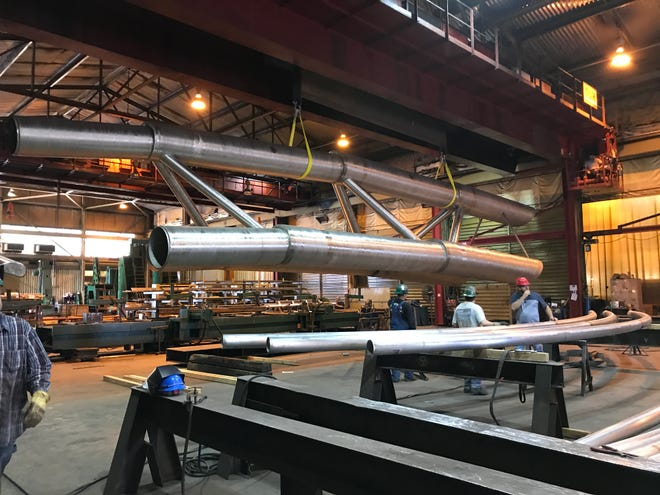 Workers at Zimmerman Metals in Denver, Colorado, are aiding in the construction of the Arc of Dreams sculpture that will be erected in downtown Sioux Falls.