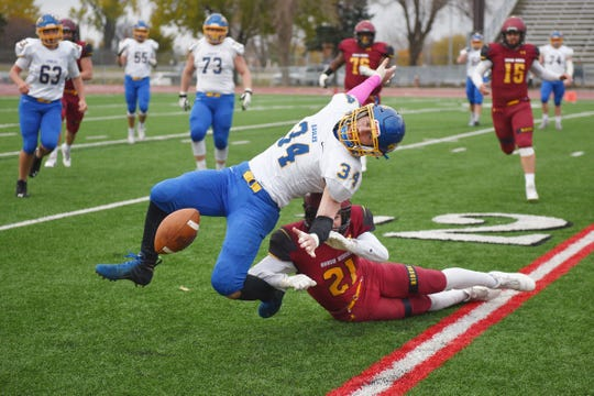 Roosevelt's Nathan Moon tackles Aberdeen Central's Dillion Stoebner Thursday, Oct. 25, at Howard Wood Field in Sioux Falls.