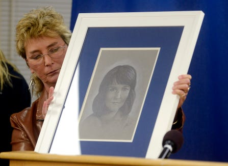 Tina Curl holds a portrait of her daughter, Becky O'Connell, following the execution of Donald Moeller Tuesday night at the South Dakota State Penitentiary in 2012.
