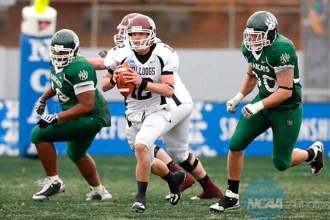 13 Dec 2008: University of Minnesota-Duluth quarterback Ted Schlafke (center) is pursued by Northwest Missouri State defenders as he scrambles out of the pocket during the 2008 Division II Football Championship at Braly Municipal Stadium in Florence, AL.  The Bulldogs defeated the Bearcats by a score of 21-14 to take home the National Championship.  Trevor Brown, Jr/NCAA Photos