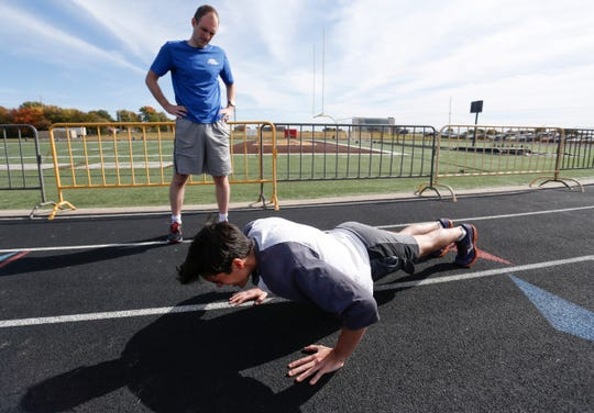 News-Leader reporter Giacomo Bologna does pushups as he takes the fitness test that prospective FBI agents must pass in order to be accepted into the FBI academy.