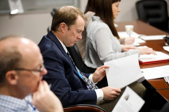 Springfield City Manager Jason Gage, center, reads through answers to questions during the Springfield City Council's interviews for a vacant seat on Thursday, Oct. 25, 2018.