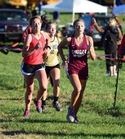 Stuarts Draft's Leah Wood, right, and Buffalo Gap's Lexi Strange, center, compete in the girls race at the Shenandoah District Cross Country Championships on Wednesday, Oct. 24, 2018, at New Market Battlefield Park in New Market, Va.