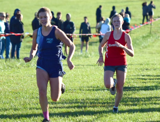 Kelsey Back, right, finished 14th in the girls race to help Riverheads finish third at the VHSL Class 1, Region B Cross Country Championships on Tuesday, Oct. 30, 2018, at New Market Battlefield Park in New Market, Va.