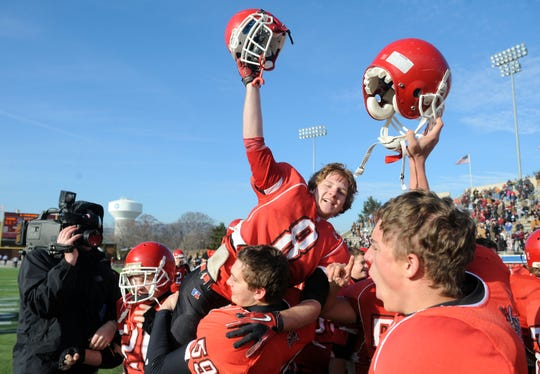 Riverheads' Jordan Jack celebrates with the team after winning the Group A, Division I  Championship in Salem on Saturday, Dec. 11, 2010.