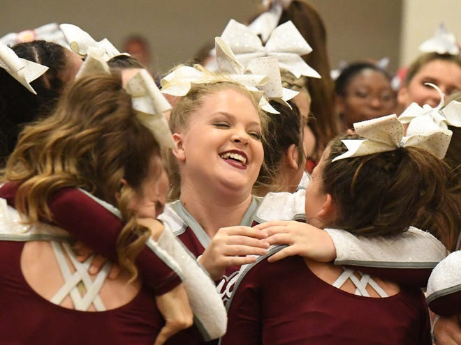 Stuarts Draft's competition cheer team celebrate their winning the Region 2B Cheer Championships in Stuarts Draft on Wednesday, Oct. 24. 2018.