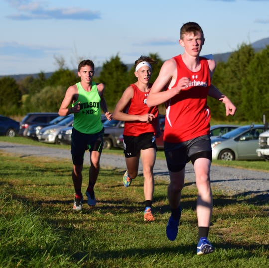 From right, Riverheads' Clay Kelly, East Rockingham's George Austin and Wilson Memorial's Vincent Leo compete in the boys race at the Shenandoah District Cross Country Championships on Wednesday, Oct. 24, 2018, at New Market Battlefield Park in New Market, Va.