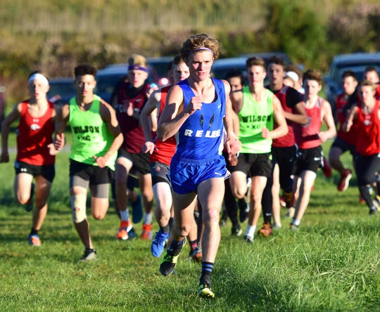 Robert E. Lee's Oliver Wilson Cook leads the pack in the opening stages of the boys race at the Shenandoah District Cross Country Championships on Wednesday, Oct. 24, 2018, at New Market Battlefield Park in New Market, Va.