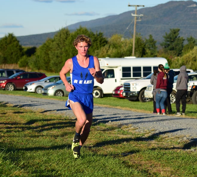 Robert E. Lee's Oliver Wilson Cook heads into the final mile of the boys race at the Shenandoah District Cross Country Championships on Wednesday, Oct. 24, 2018, at New Market Battlefield Park in New Market, Va.