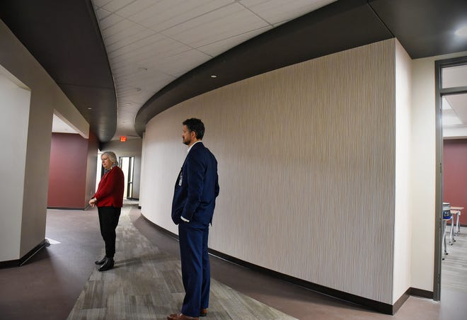 Director of Development and Communication Sandy Nadeau and Executive Director Charles Hempeck talk about features Thursday, Oct. 25, of the new Anna Marie's Alliance Center for Family Peace in St. Cloud.