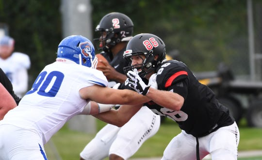 St. Cloud State tight end Sam Hartman (86) blocks University of Mary's Devon Macias at Husky Stadium. Hartman has caught 10 passes for 154 yards and two TDs this season.