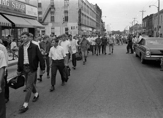 Members of the St. Cloud Platoon on their way to a bus to take them into military service in August 1968.