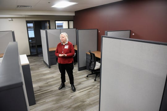 Director of Development and Communication Sandy Nadeau talks about features in a staff area of the new Anna Marie's Alliance Center for Family Peace in St. Cloud.