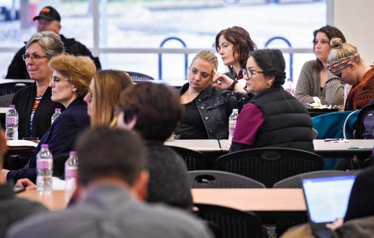 Audience members listen as local candidates answer questions during an election forum held by the St. Cloud Area Chamber of Commerce Thursday, Oct. 25, at the Sauk Rapids Government Center.