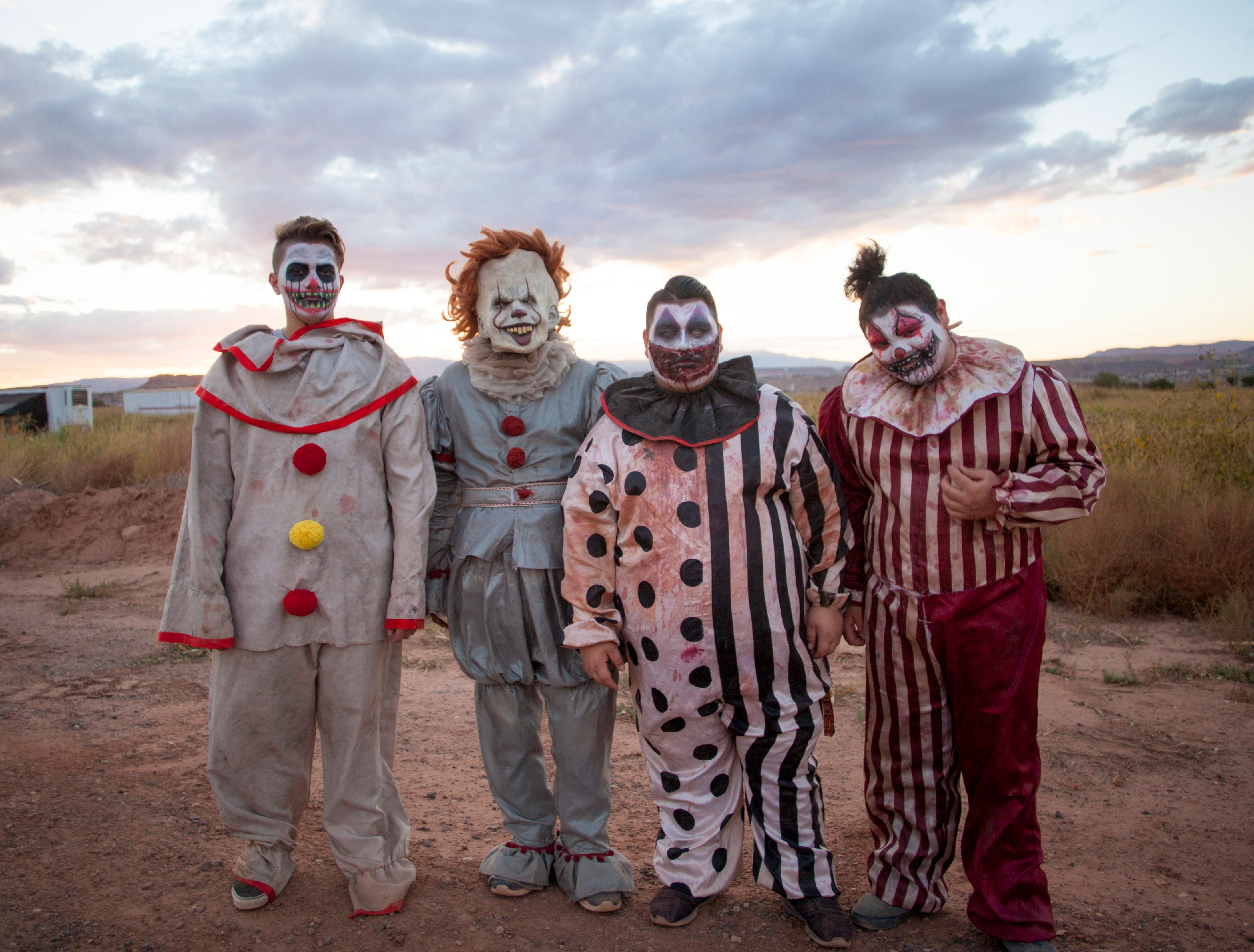 The Field of Screams cast prepares for another night of scaring thrill seekers at the Staheli Family Farm Saturday, Oct. 20, 2018.