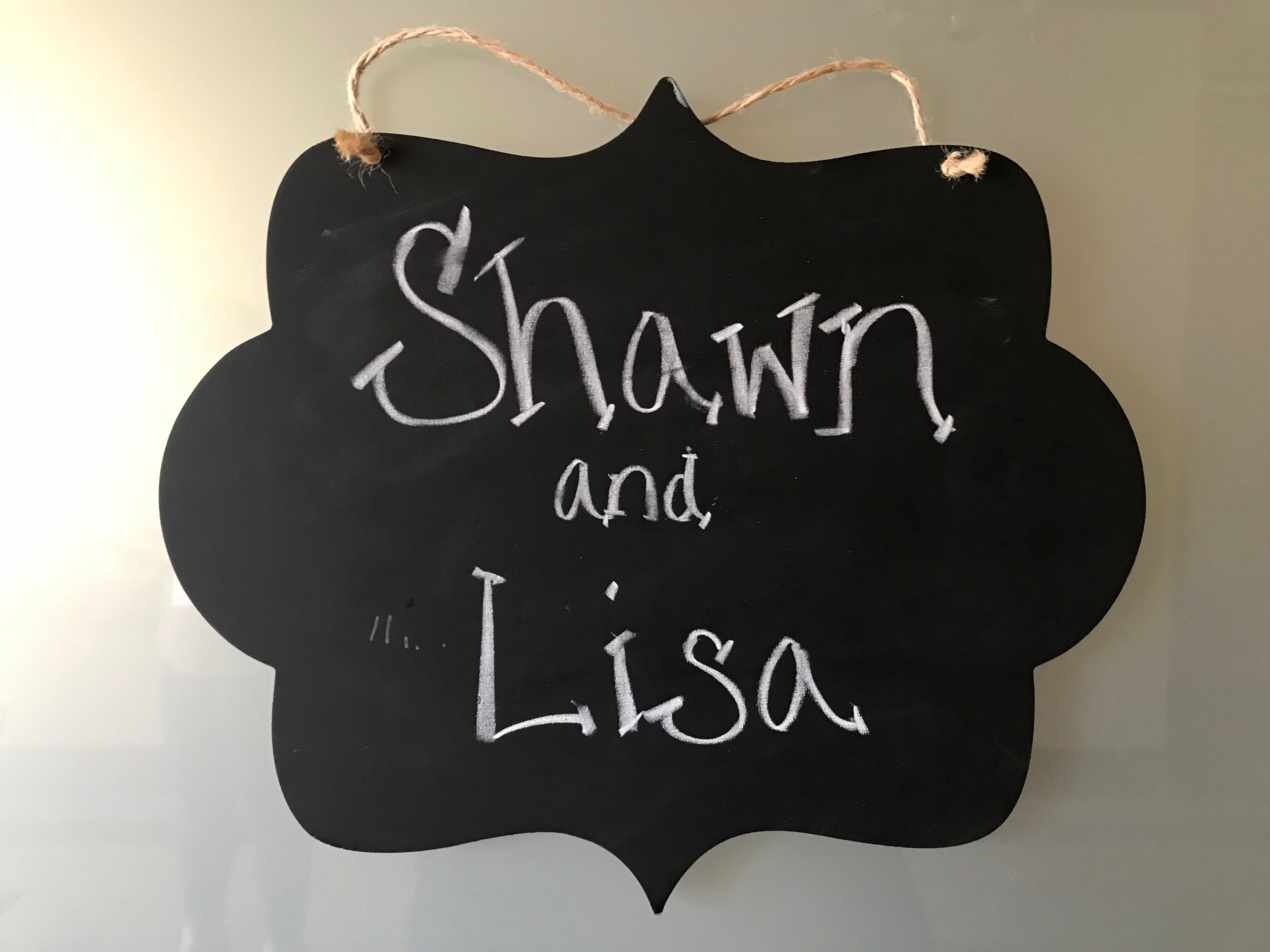 A sign announces the names of the bride and groom on the conference room-turned-wedding chapel at Ministry Home Care in Plover.