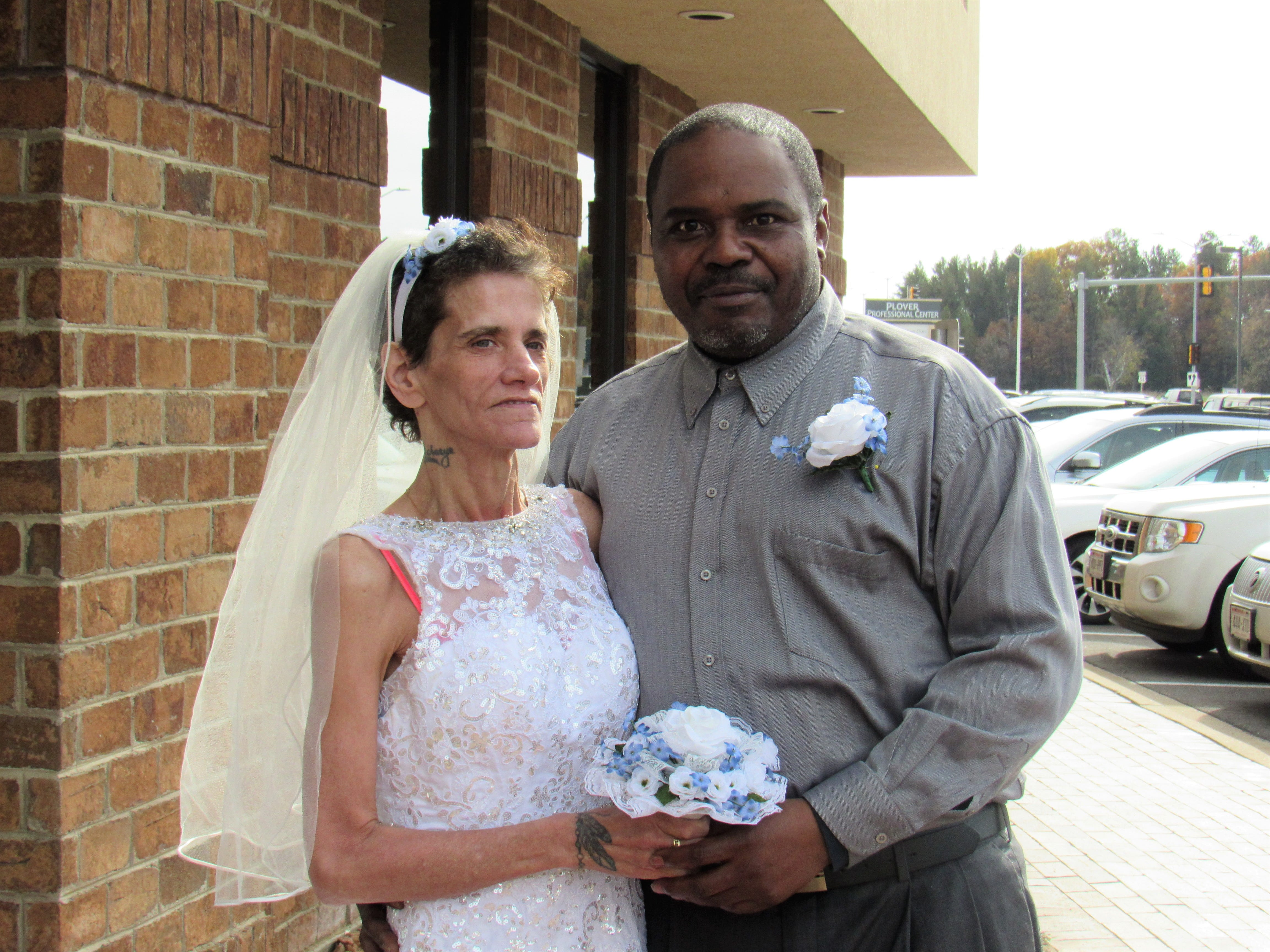 Lisa Fredrick and Shawn Ivy pose for photos after their wedding ceremony on Thursday, Oct. 25, 2018, outside the Ministry Home Care office in Plover.