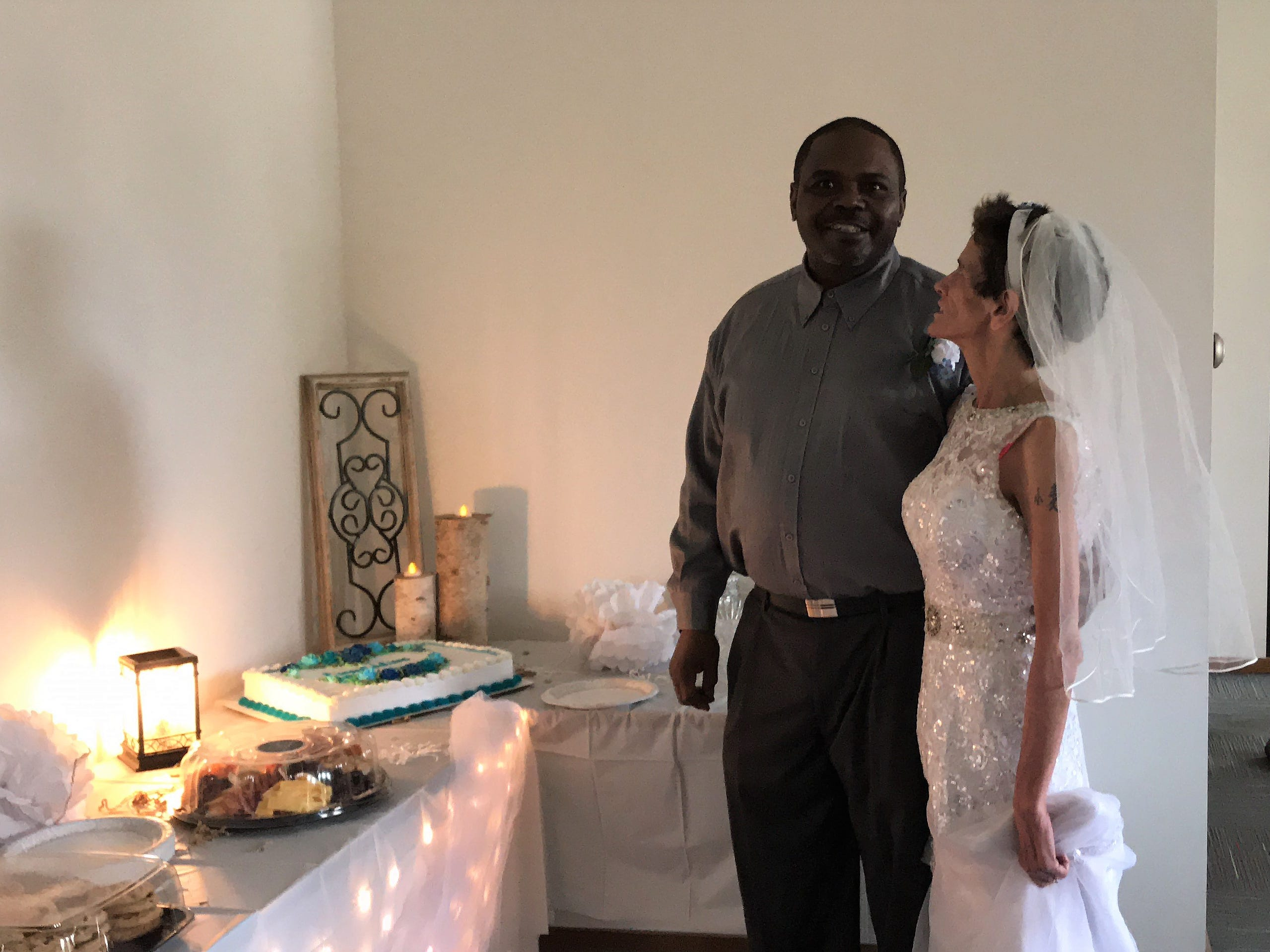Shawn Ivy and his new bride, Lisa Fredrick, wait to cut their wedding cake on Thursday, Oct. 25, 2018, in the Ministry Home Care conference room in Plover.
