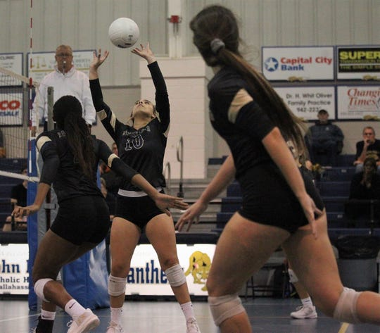 Mary Claire Ricco sets a ball as the St. John Paul II volleyball team won a 3-0 regional semifinal match against St. Johns Country Day.