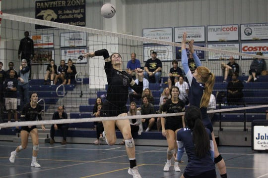 Allison Cross goes for a kill as the St. John Paul II volleyball team won a 3-0 regional semifinal match against St. Johns Country Day.