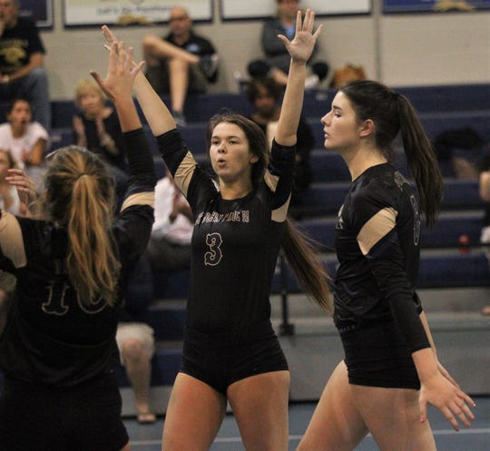 Sam Taylor (3) celebrates Allison Cross's ace as the St. John Paul II volleyball team won a 3-0 regional semifinal match against St. Johns Country Day.